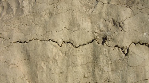 Jagged crack across a wall